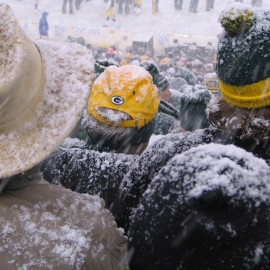 Green Bay Packers fans fill the stadium despite an active snowstorm, photographed on January 12, 2008. Collective ownership of the Packers has created a loyal community that is even willing to volunteer to shovel the field during inclement weather. Should this be a model for ownership of other sports teams, or in other industries? (Flickr / akahodag)