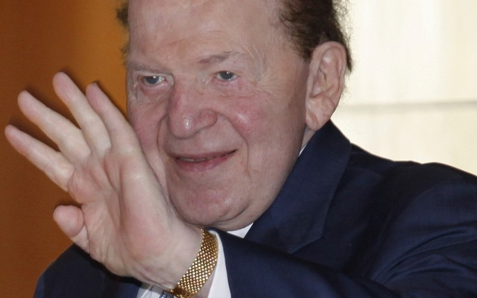 This June 7, 2011, file photo shows Las Vegas Sands Chairman and CEO Sheldon Adelson waving to reporters as he arrived for Sands China's annual meeting in Hong Kong.Adelson and his wife, Miriam, have pumped $10 million into a political action committee backing Gingrich. Campaign finance experts say the pair of $5 million contributions is among the largest known political donations in U.S. history. (AP Photo/Vincent Yu, File)