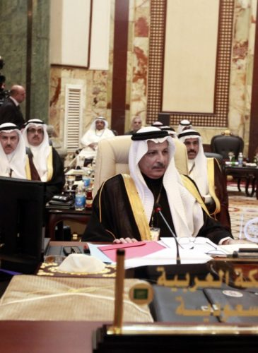 Saudi Arabia's permanent representative to the League of Arab States Ahmad al-Qattan, center, attends the Arab League summit in Baghdad, Iraq, Thursday, March, 29, 2012. The annual Arab summit meeting opened in the Iraqi capital Baghdad on Thursday with only 10 of the leaders of the 22-member Arab League in attendance and amid a growing rift between Arab countries over how far they should go to end the one-year conflict in Syria. (AP Photo/Karim Kadim)