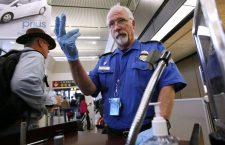 TSA officer Robert Howard signals an airline passenger forward at a security check-point at Seattle-Tacoma International Airport, Monday, Jan. 4, 2010 (AP Photo/Elaine Thompson)