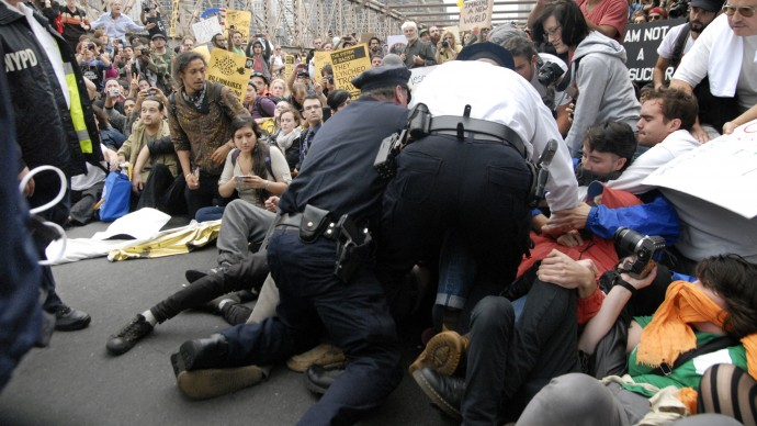 In this October 1, 2011 photo, police make their way a crowd of protesters who were the front line on New York's Brooklyn Bridge when police began making arrests during a march by Occupy Wall Street. (AP Photo/Stephanie Keith)