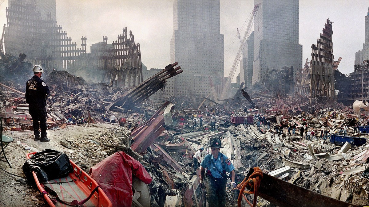 In this Monday, Sept. 24, 2001 file photo, rescue workers examine the site of the Sept. 11, 2001 World Trade Center terrorist attacks in New York. (AP Photo/Ted S. Warren, Pool, File)