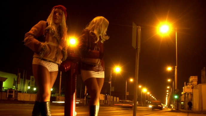 Two prostitutes wait for clients beside a suburban road in this file photo. (AP Photo/Bela Szandelszky, file)