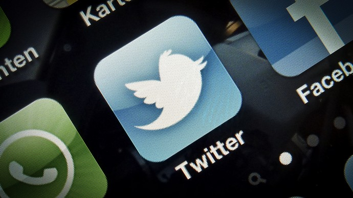 A photo illustration shows the icon of the Twitter app on a smartphone. (Photo Timur Emek/file)