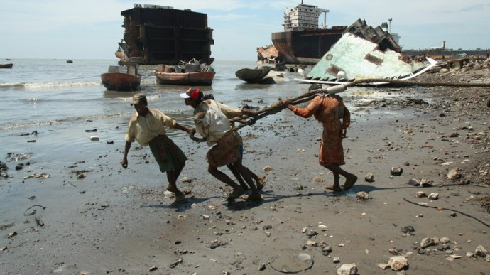 Men work in the shipbreaking yards of Chittagong, Bangladesh, in 2009. (Photo by YPSA 2009)