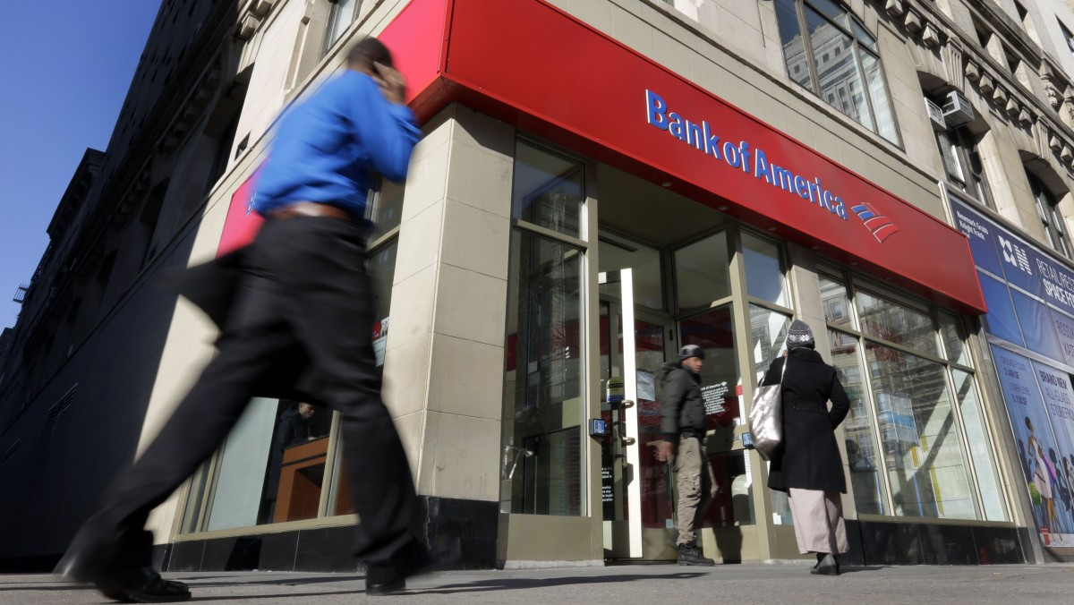 People pass a Bank of America branch, in New York, Monday, Jan. 7, 2013. (AP Photo/Richard Drew)