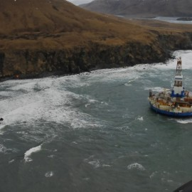 In this image provided by the U.S. Coast Guard the conical drilling unit Kulluk sits grounded near a beach 40 miles southwest of Kodiak City, Alaska, Thursday, Jan. 3, 2012. (AP Photo/U.S. Coast Guard, Petty Officer 2nd Class Zachary Painter)