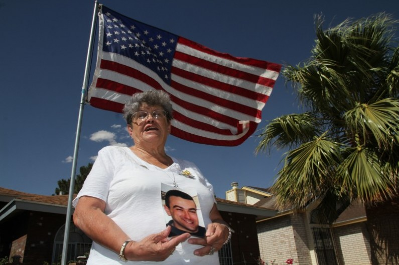 "Lillian ""Bonnie"" D'Amico, poses for a photograph while holding a photo of her son Nicholas D'Amico in El Paso, Texas, Wednesday, June 11, 2014. Her son killed himself while waiting for a an appointment with a psychiatrist. Some Veterans Affairs facilities in Texas have among the longest wait-times in the nation for those trying to see a doctor for the first time, according to federal data released Monday. (AP Photo/Juan Carlos Llorca)"