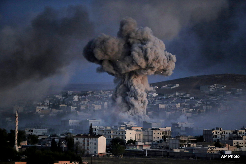 Thick smoke from an airstrike by the US-led coalition rise in Kobani, Syria