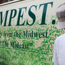 The Hempest's proprierter, wearing a baseball cap, leans against the logo van, with the slogan Energy From The Midwest Not The Mideast.