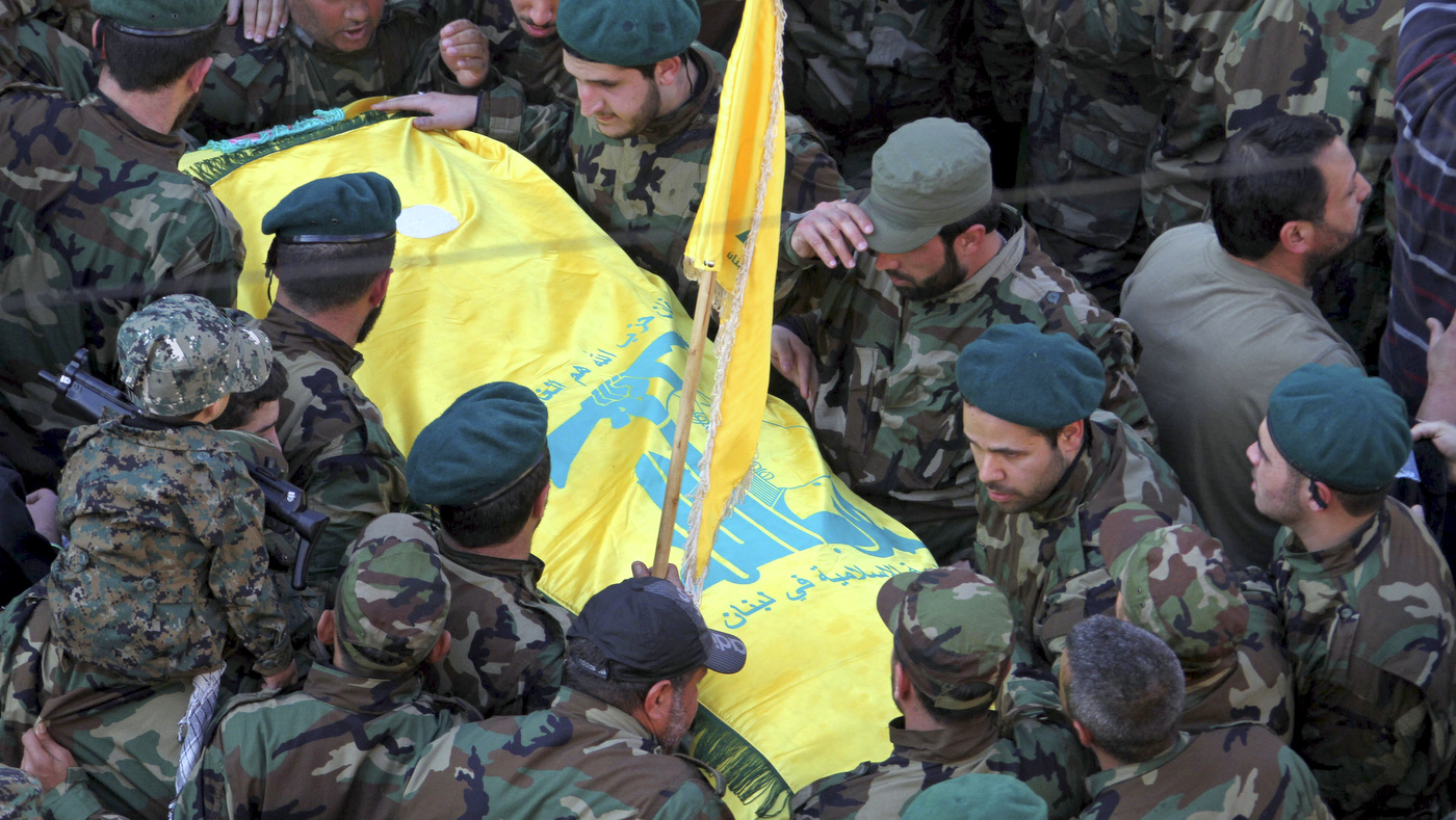 Hezbollah fighters carry the coffin of Hezbollah member Mohammad Issa who was killed in an airstrike that killed six members of the Lebanese militant group and an Iranian general in Syria, during his funeral procession, in the southern village of Arab Salim, Lebanon, Tuesday, Jan. 20, 2015. Hezbollah has accused Israel of carrying out Sunday's airstrike, which occurred on the Syrian side of the Golan Heights. Issa was the highest-ranking among the group, and was among the senior cadres who headed the group's operations in Syria against the Sunni-led rebellion. (AP Photo/Mohammed Zaatari)