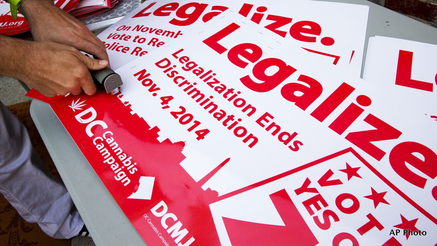 FILE - In this Oct. 9, 2014 file photo, posters encouraging people to vote yes on DC Ballot Initiative 71 to legalize small amounts of marijuana for personal use are readied in Washington.  (AP Photo/Jacquelyn Martin, File)