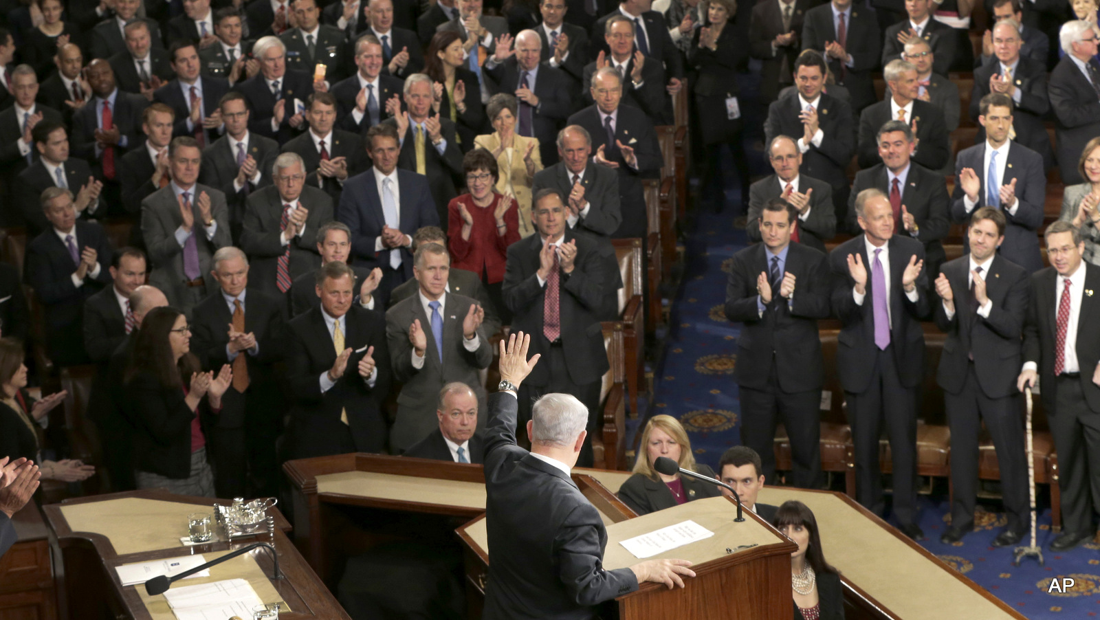 Benjamin Netanyahu waves after speaking before a joint meeting of Congress on Capitol Hil
