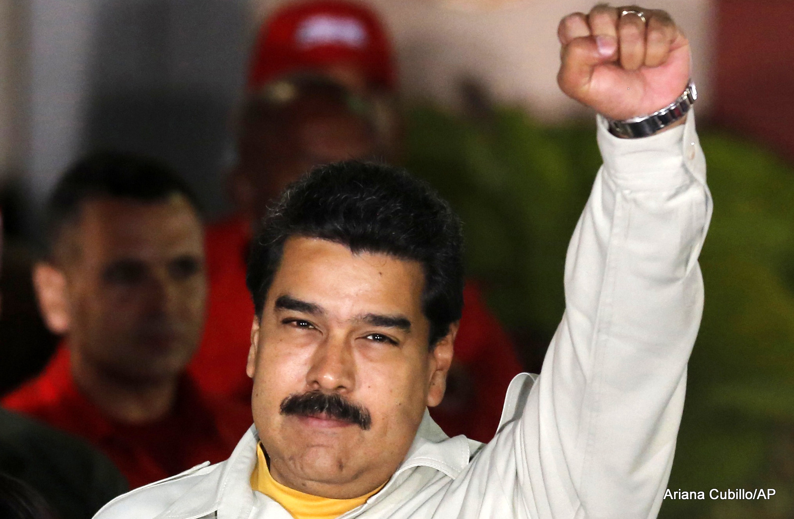 Venezuela's President Nicolas Maduro holds up a clenched fist as he greets supporters during an event at Miraflores presidential palace in Caracas, Venezuela. In a fiery speech late Monday, March 9, 2015.
