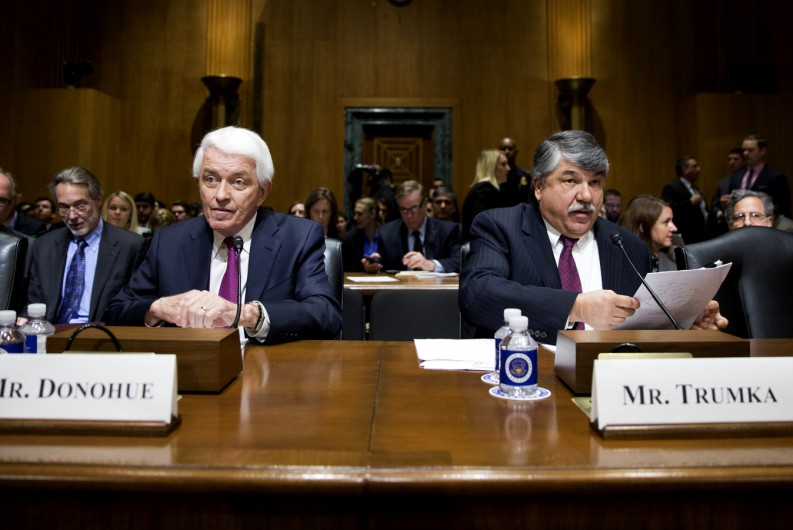 """Major labor unions and business groups clashed Tuesday over President Barack Obama's bid for """"fast track"""" authority to advance trade deals being negotiated with numerous nations. TAFL-CIO president Richard Trumka, right, and U.S. Chamber of Commerce President Tom Donohue prepare to testify on Capitol Hill in Washington, Tuesday, April 21, 2015, before a Senate Finance Committee hearing on Obama's bid for """"fast track"""" authority to advance trade deals being negotiated with numerous nations. in shaping trade deals."""