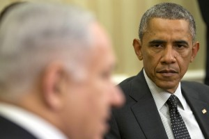 President Barack Obama listens as Israeli Prime Minister Benjamin Netanyahu speaks during their meeting in the Oval Office of the White House in Washington, Wednesday, Oct. 1, 2014.