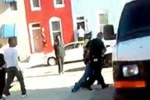 A screenshot from a video showing Baltimore police dragging Freddie Gray into a police vehicle moments before his death.