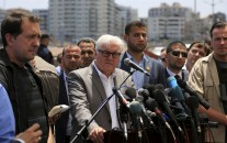 Germany's Foreign Minister Frank-Walter Steinmeier, centre, talks during a press conference at fishermen's port in Gaza City, northern Gaza Strip, Monday, June 1, 2015. Steinmeier paid a rare visit to the Hamas-ruled Gaza Strip on Monday, calling on Israel to ease a blockade on the territory and urging Hamas prevent rockets from being fired into Israel.
