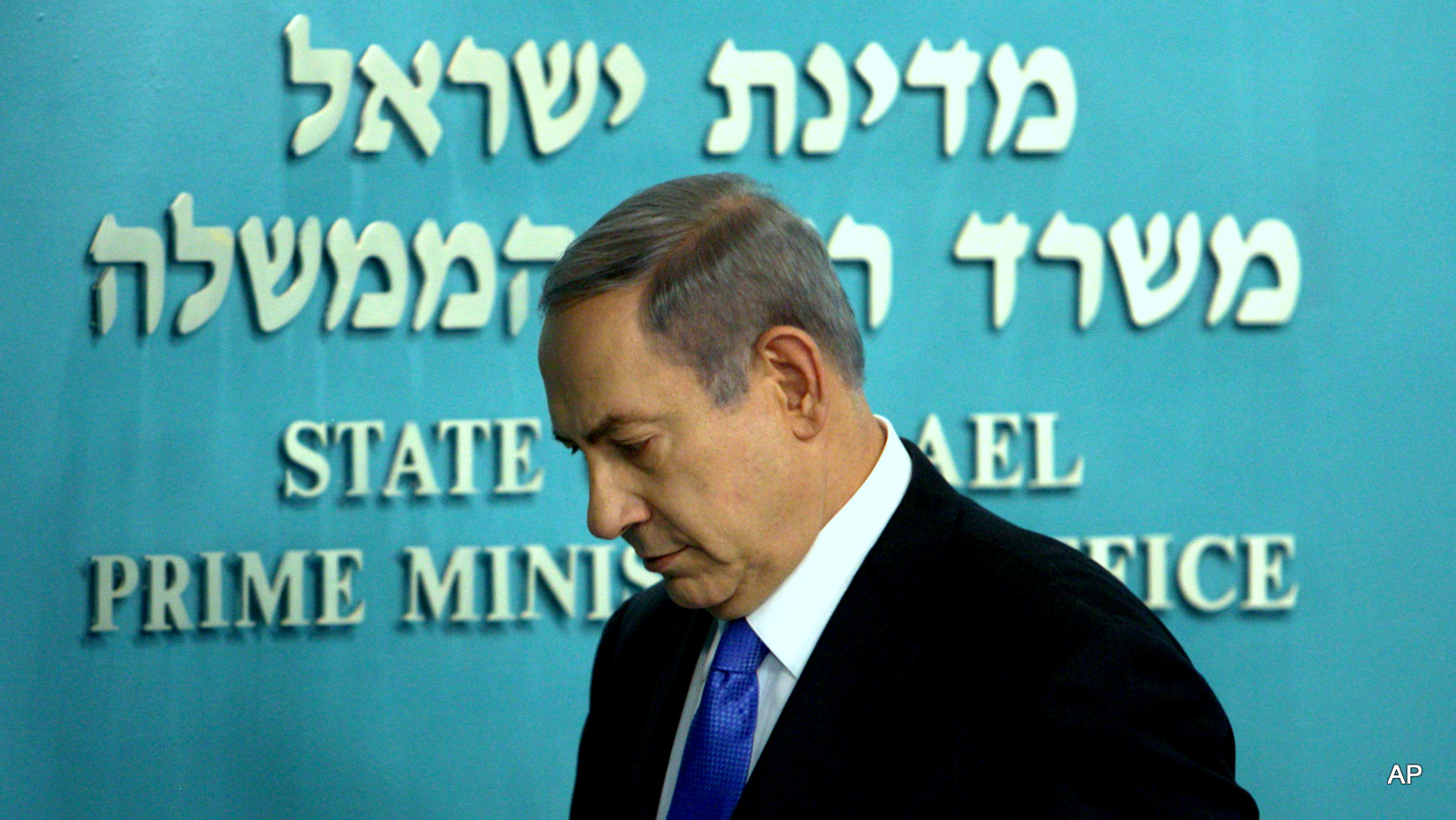 Benjamin Netanyahu walks out following a press conference at his Jerusalem office