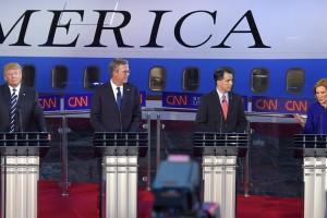 Republican presidential candidate, businesswoman Carly Fiorina, right, speaks as, from left, Donald Trump, Jeb Bush, and Scott Walker look on during the CNN Republican presidential debate at the Ronald Reagan Presidential Library and Museum on Wednesday, Sept. 16, 2015, in Simi Valley, Calif. (AP Photo/Mark J. Terrill)