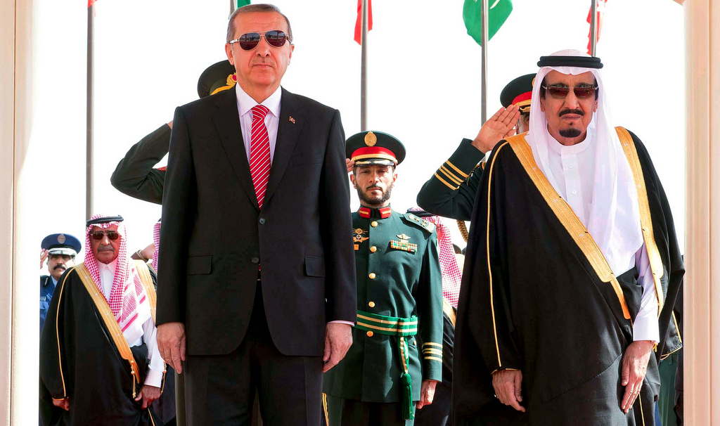 In this photo provided by the Saudi Press Agency, Turkey's President Recep Tayyip Erdogan, left, stands with Saudi King Salman during an arrival ceremony, in Riyadh, Saudi Arabia, Monday, March 2, 2015. (AP Photo/SPA)
