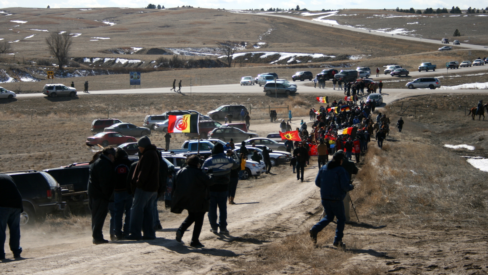 Members of the American Indian Movement walk to the Wounded Knee Massacre Monument Wednesday, Feb. 27, 2013 in Wounded Knee, S.D. (AP Photo/Kristi Eaton)
