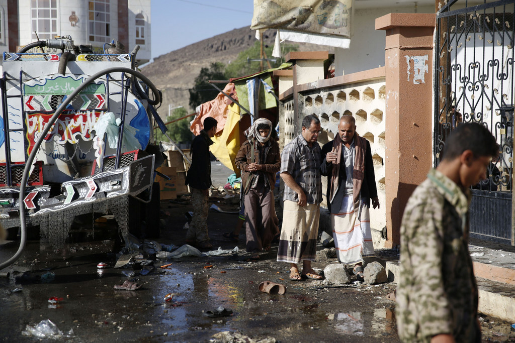 People inspect the site after a suicide bomb attack, Tuesday night, next to a mosque in Sanaa, Yemen, Wednesday, Oct. 7, 2015. The attack killed seven people and wounded three. Islamic State militants claimed responsibility for the blast online. (AP Photo/Hani Mohammed)