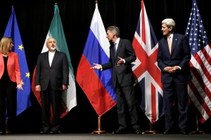 British Foreign Secretary Philip Hammond, second right, U.S. Secretary of State John Kerry, right, and European Union High Representative for Foreign Affairs and Security Policy Federica Mogherini, left, talk to Iranian Foreign Minister Mohammad Javad Zarif as the wait for Russian Foreign Minister Sergey Lavrov, not pictured, for a group picture at the Vienna International Center in Vienna, Austria. Iran sits down with the United States, Russia, Europeans and key Arab states for the first time since the Syrian civil war began to discuss the future of the war-torn country. It will also break ground by bringing President Bashar Assad's main supporter, Iran, to the same table as its regional rivals, including Turkey and Saudi Arabia, who have been backing many of the insurgent groups. (Carlos Barria, Pool Photo via AP, File)