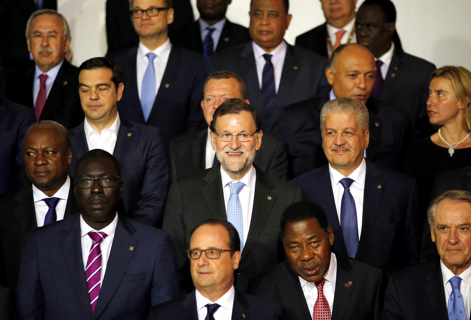 Spain's Prime Minister Mariano Rajoy, center, smiles as he poses for a family picture with European Union and African leaders on the occasion of an informal summit on migration in Valletta, Malta, Wednesday, Nov. 11, 2015. (AP Photo/Antonio Calanni)