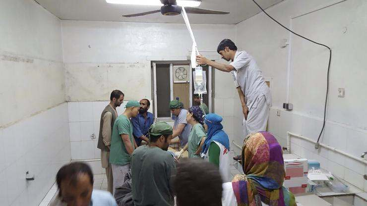 Afghan surgeons work inside a Medecins Sans Frontieres (MSF) hospital after an air strike in the city of Kunduz, Afghanistan, on Saturday. Photo: Medecins Sans Frontieres