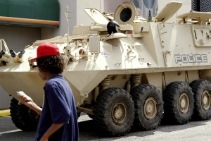 An armored vehicle used by state and local authorities for drug enforcement is brought into the city for school kids to tour in New Orleans/ (AP Photo/Alex Brandon)