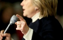 Democratic presidential candidate Hillary Clinton gestures as she speaks at a town hall at the Toledo Civic Center in Toledo, Iowa, Monday, Jan. 18, 2016. (AP Photo/Patrick Semansky)