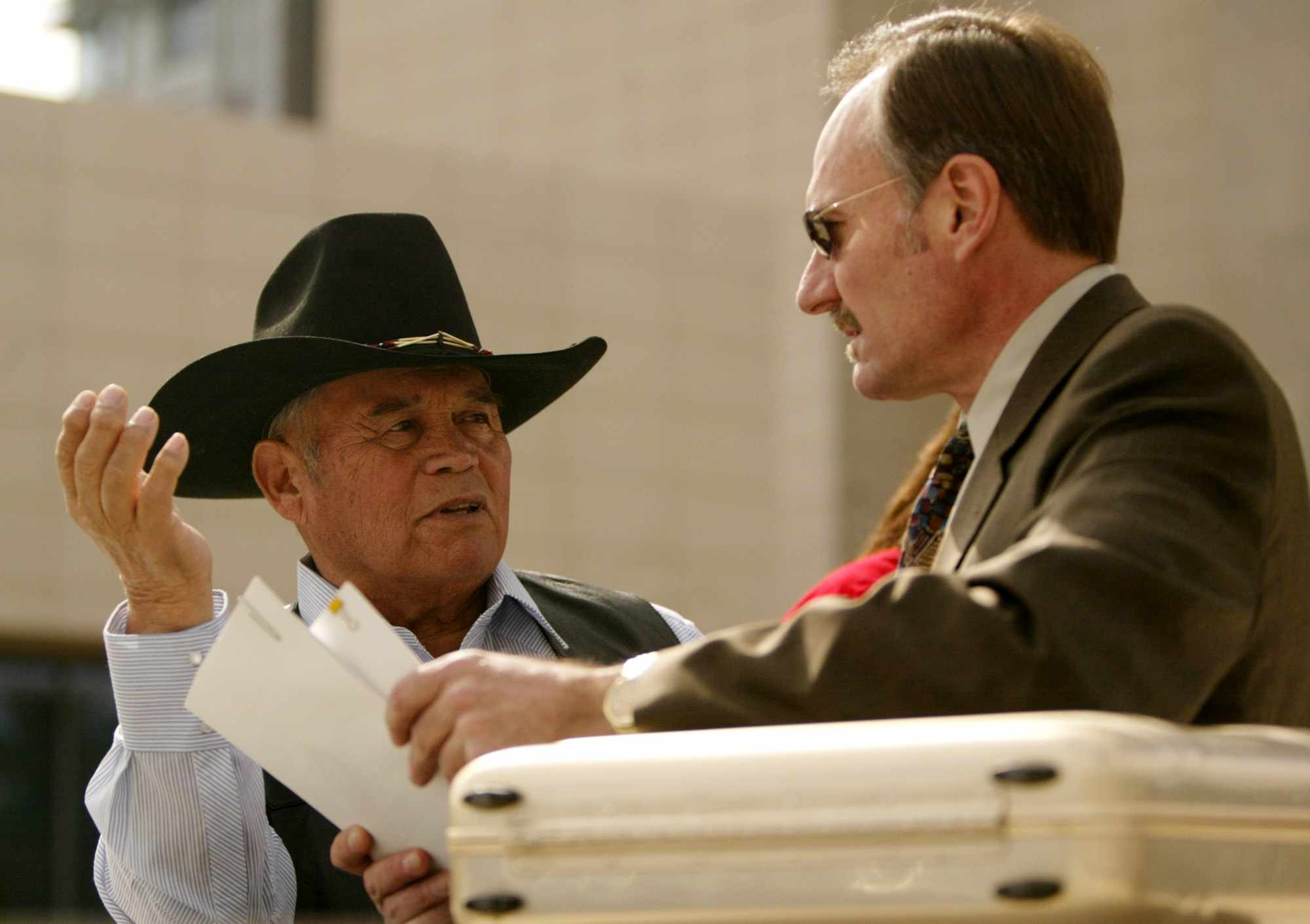 Chief Raymond Yowell of the Western Shoshone Nation, left, confers with tribal attorney Robert Hager, at the U.S. Federal Courhouse in Las Vegas, Friday, March 4, 2005. The tribe filed a lawsuit against the federal government saying a 19th century treaty with the federal government prohibits building a nuclear dump on the Yucca Mountain site that Congress and the Bush administration picked for the repository. (AP Photo/Joe Cavaretta)