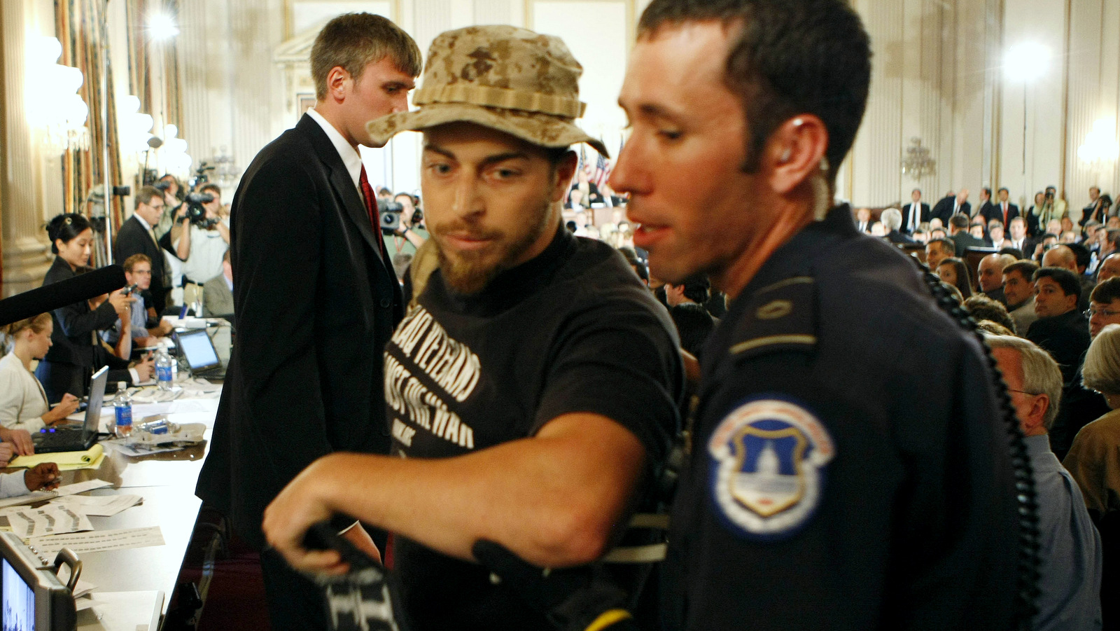 Former Marine Adam Kokesh is detained by Capitol Hill Police on Capitol Hill in Washington, Monday, Sept. 10, 2007, as Gen. David Petraeus and U.S. Ambassador to Iraq Ryan Crocker testified before the House Armed Services Committee hearing on the future course of the war in Iraq. (AP Photo/Gerald Herbert)