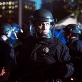Riot police amass at the Occupy Denver protest in front of the state Capitol building Friday, Oct. 14, 2011. (AP Photo/Thomas Peipert)