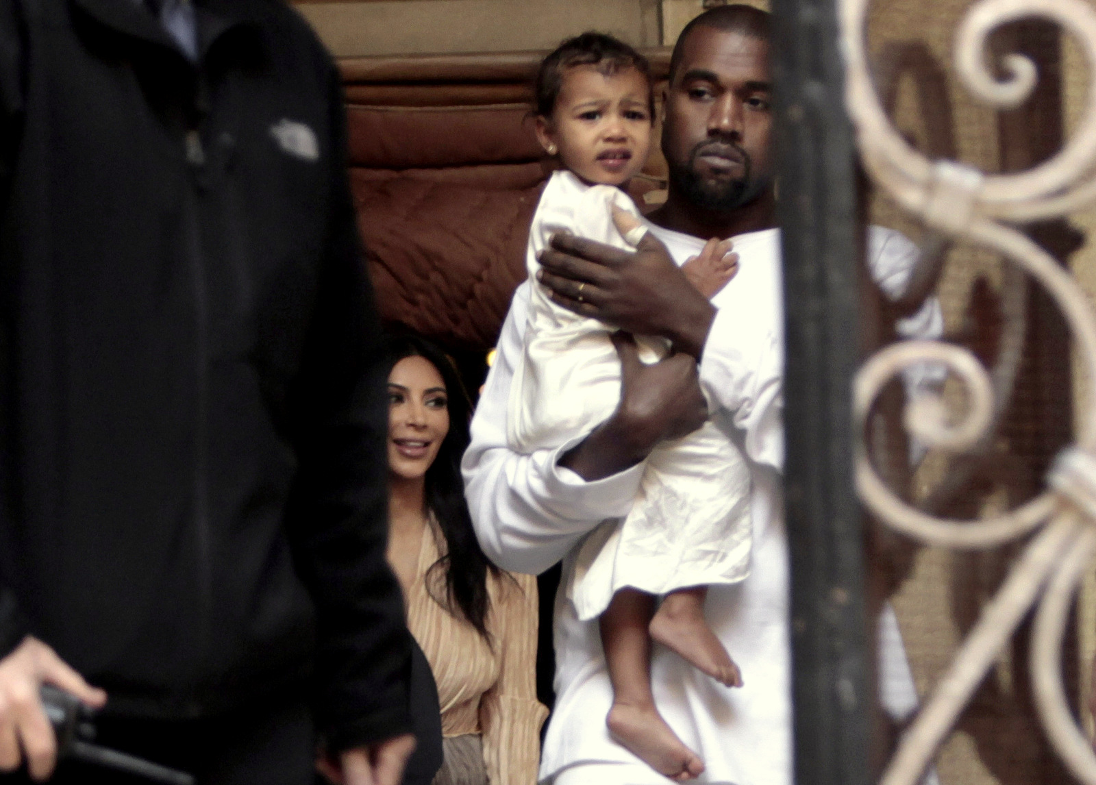 Kim Kardashian, a US reality TV star, and her husband Kanye West holding their daughter North West, walk inside Armenian St. James Cathedral, in Jerusalem, Monday, April 13, 2015. (AP Photo/Mahmoud Illean)