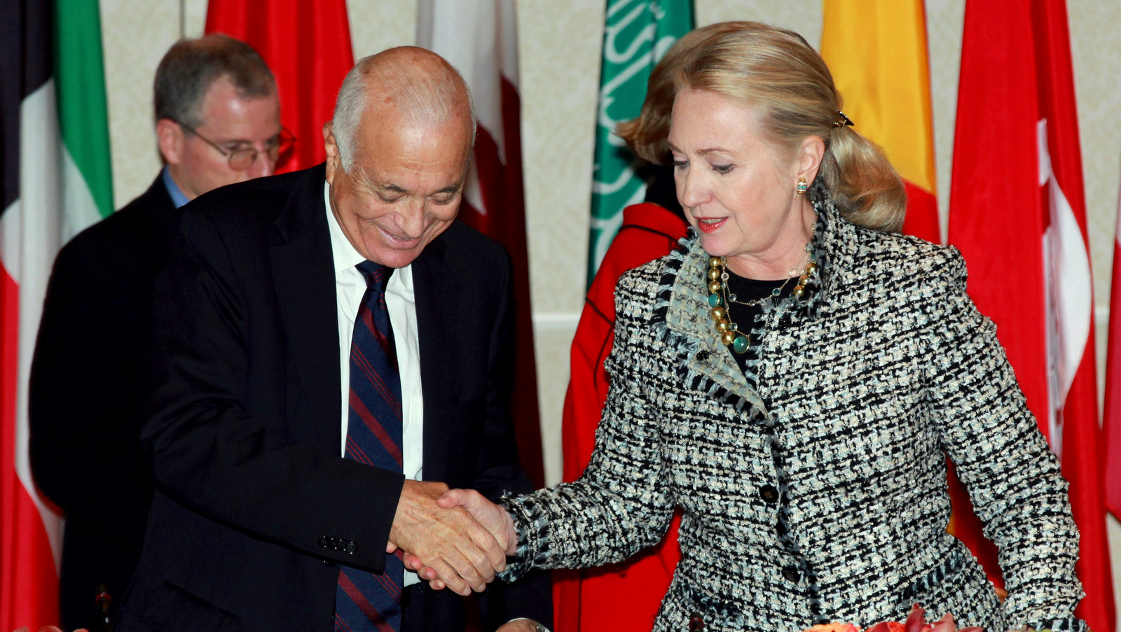 Secretary of State Hillary Rodham Clinton, right, welcomes Nabil Elaraby, left, Head of the Arab League as she hosts a gathering of Friends of Syria group on Friday, Sept. 28, 2012 in New York. (AP Photo/David Karp))