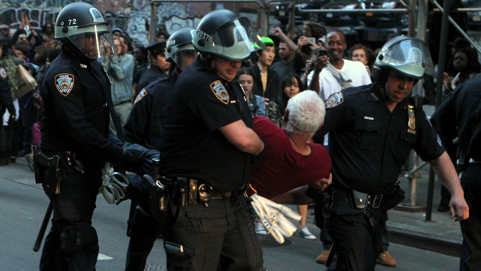 The NYPD arrest an eledery man protesting the death of Baltimore, Maryland Police victim Freddie Gray in a show of solidarity in the Union Square section of New York City on April 29, 2015 in New York City. (Credit: RTNJennings/MediaPunch/IPX)