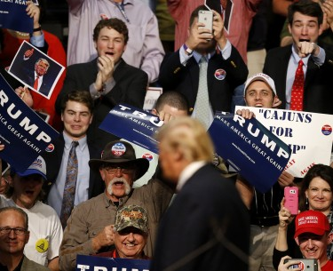 The crowd cheers as Republican presidential candidate Donald Trump speaks at a campaign rally in Baton Rouge, La., Thursday, Feb. 11, 2016. (AP Photo/Gerald Herbert)