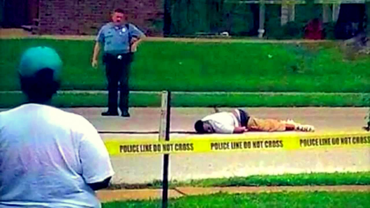 Michael Brown lays dead in the street after being shot and killed by police in Ferguson, Missouri.