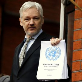 WikiLeaks founder Julian Assange stands on the balcony of the Ecuadorean Embassy to addresses waiting supporters and media in London, Friday, Feb. 5, 2016.