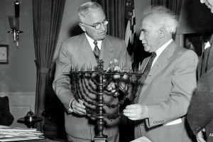 President Harry Truman receives an ornate bronze menorah as a birthday gift from David Ben-Gurion, prime minister of Israel, who called on the chief executive to discuss peace and economic development in the Middle East, May 8, 1951. Ben-Gurion said the menorah was made in 1767. This is the president's 67th birthday. (AP Photo/Henry Griffin)