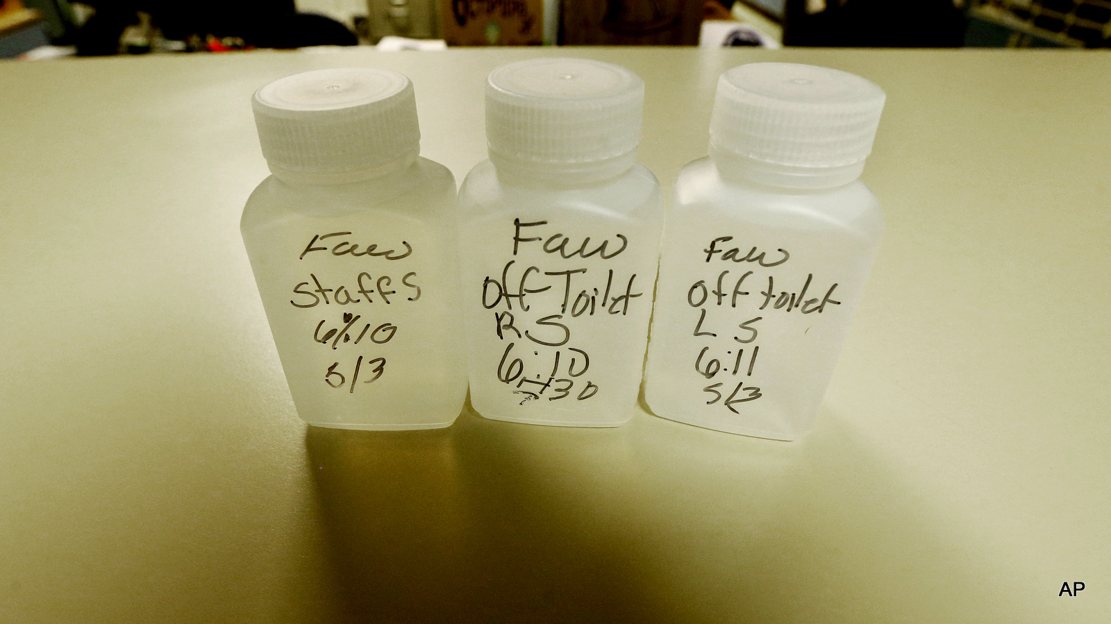 Water samples for lead testing sit on an office counter top at Fawcett Elementary School in Tacoma, Wash. After Tacoma Public Schools revealed last month that multiple elementary schools tested positive for lead in the drinking water