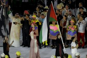 Mayada Al-Sayed carries the flag of Palestine during the opening ceremony for the 2016 Summer Olympics in Rio de Janeiro, Brazil, Friday, Aug. 5, 2016.