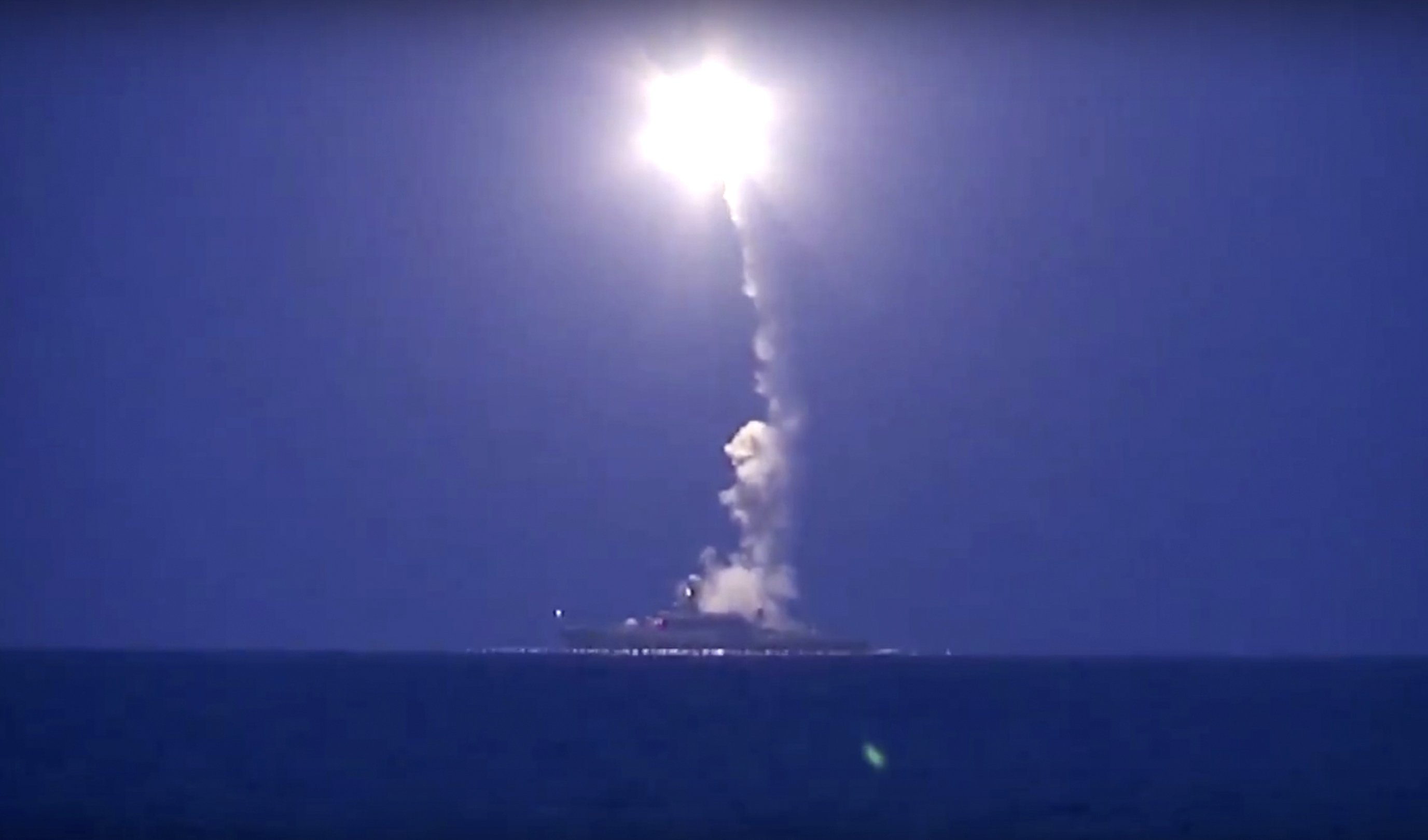 Russian navy ship launches a cruise missile in the Caspian Sea. (Russian Defense Ministry Press Service via AP)