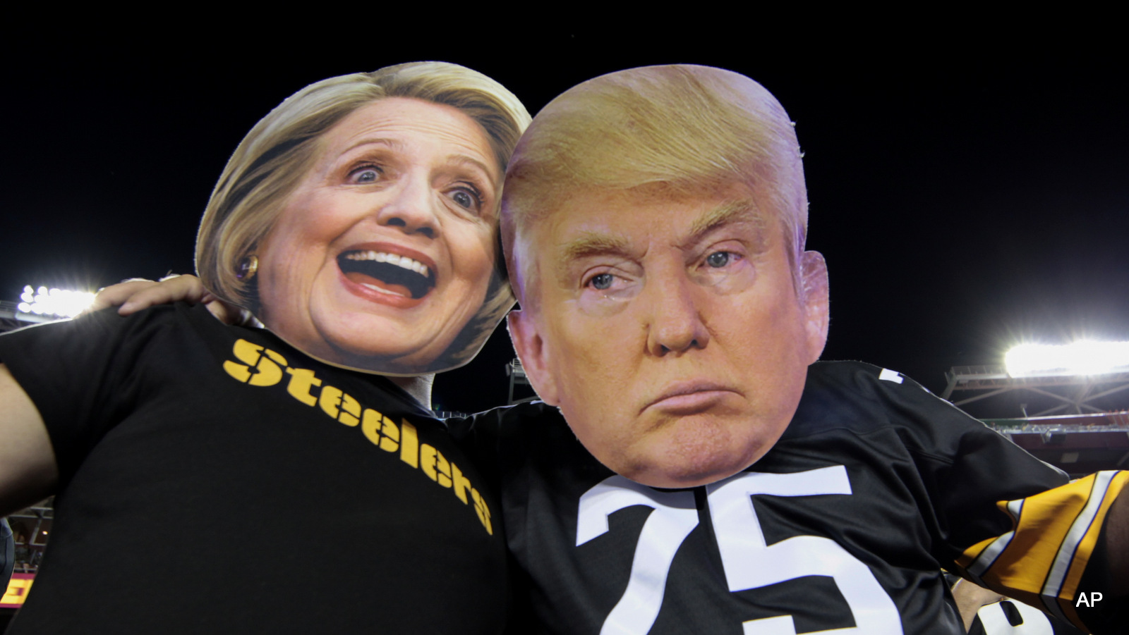 Pittsburgh Steelers fans Brian Picchini (left) and Rusty Kuchta (right) wear presidential candidates Sec. Hillary Clinton and Donald J. Trump masks during the first half of an NFL football game against the Washington Redskins in Landover, Md., Monday, Sept. 12, 2016.