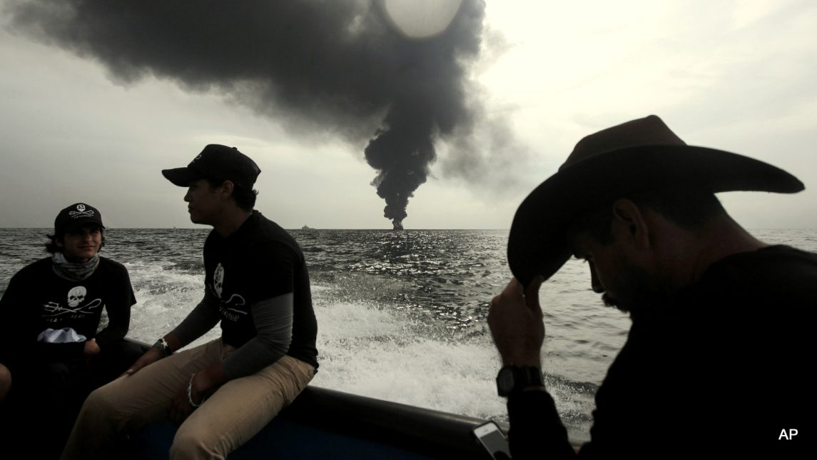 Members of the marine wildlife conservation organization Sea Shepherd monitor the fuel tanker Burgos, as it continues to burn a day after it erupted in flames off the coast of the port city of Boca del Rio, Mexico, Sunday Sept. 25, 2016. Firefighting boats were battling the blaze aboard the Burgos, which is owned by state oil company Petroleos Mexicanos, or Pemex. Pemex said in a statement Sunday that a team of international experts in putting out fires and transferring fuel has arrived to assist.