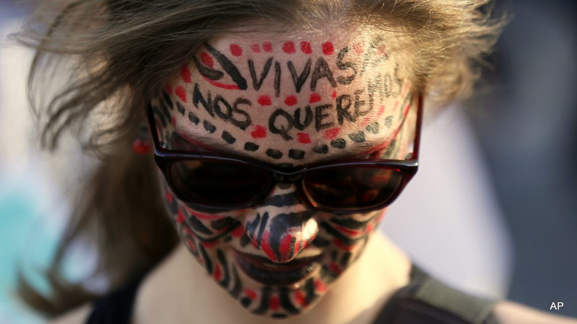 A woman with her face painted protests against gender violence in Mexico City, Wednesday, Oct. 19, 2016. Women across Latin America participated in protests in response to the shocking rape and killing of a teenage girl on Oct. 8 in Argentina.
