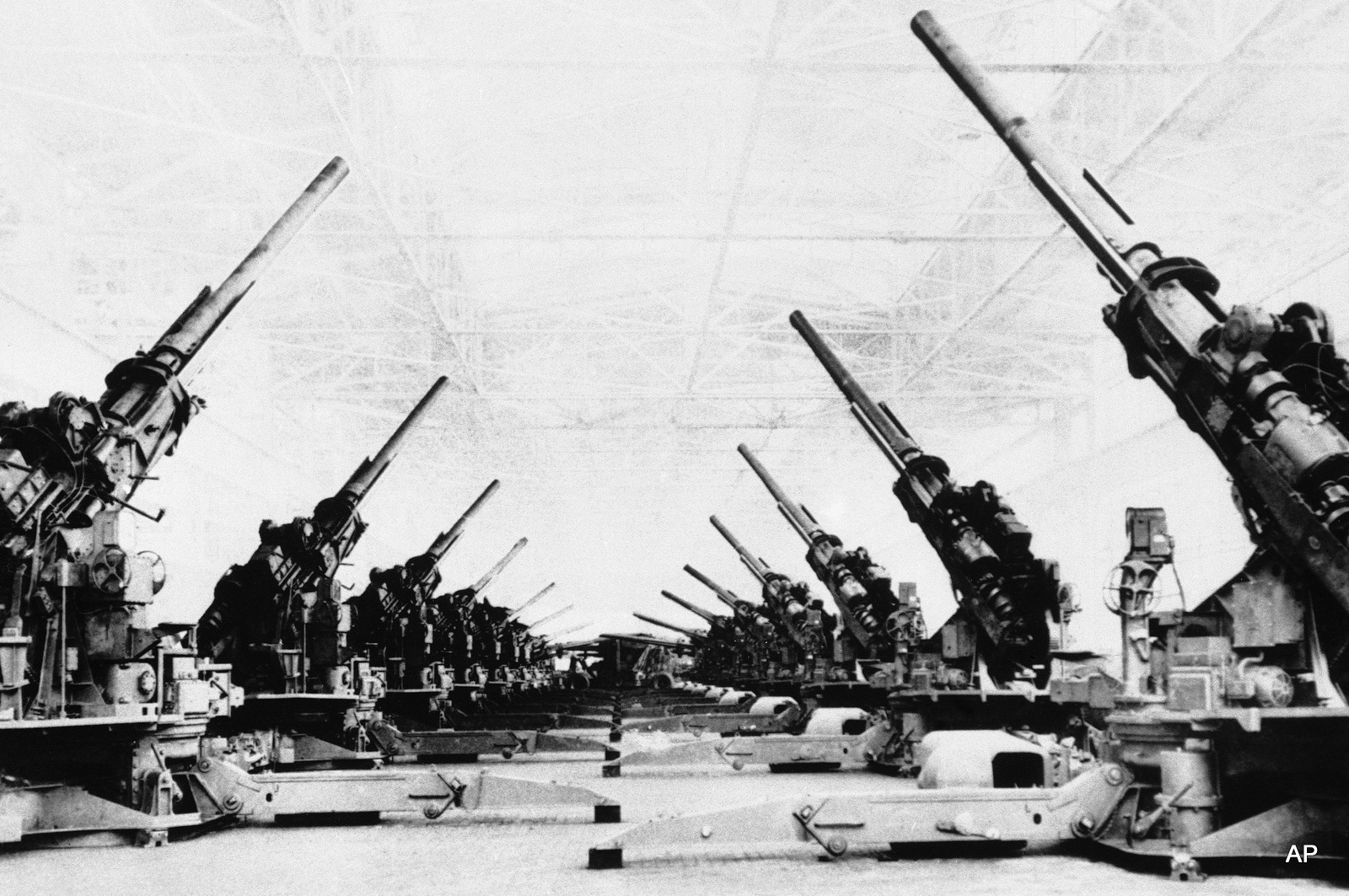 U.S.Army 4.7mm anti-aircraft gunsare lined up in the final assembly area of the Grand Rapids stamping division of Fisher Body in Detroit on June 1, 1944, prior to shipping.