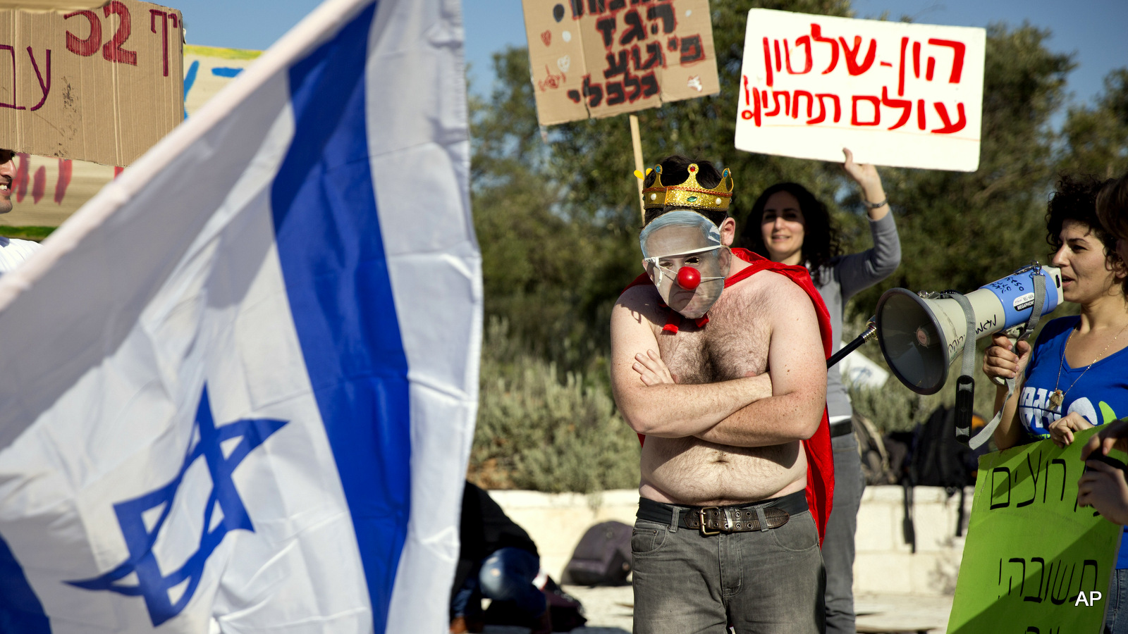 An activist wears a mask bearing a portrait of Prime Minister Benjamin Netanyahu during a protest against a natural gas deal signed in December, 2015 with U.S. and Israeli developers for drilling offshore gas deposits, in front of the Supreme Court in Jerusalem.